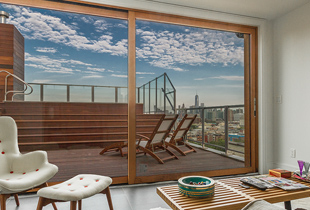 The completed penthouse offers pristine viewing of the city, pool/hot tub combo, and all of Jersey City