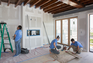 Construction crew hard at work framing out a new gas fireplace for the master bedroom