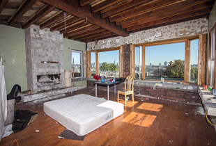 Much like the master bedroom, the parlor level sitting area held only a dirty mattress and junk