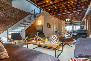 Soaring ceilings, exposed original beams and a fully open floor plan are just a few of the amenities offered by Ogden Avenue