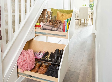 Hideaway storage drawers under staircase
