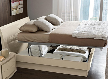 Storage bed that lifts up to provide storage underneath