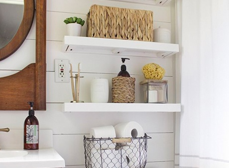 Floating white bathroom shelves