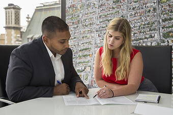 Jameel-and-Ingrid-reviewing-paperwork