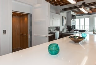 Right off the kitchen, you'll find a personal elevator that goes all the way to the penthouse