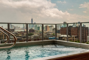 Bubbling hot tub with skyscrapers rising in the background
