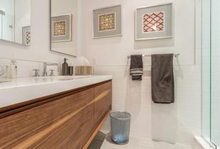 Stunning floating wood vanities create a modern aesthetic in the bathrooms
