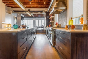 Cabinets and storage as far as the eye can see in this chef's kitchen