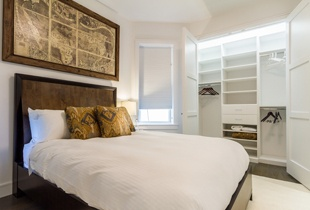 Stunning bedrooms offer ample closet space with custom organization