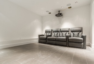 The downstairs media room has four luxurious leather recliners