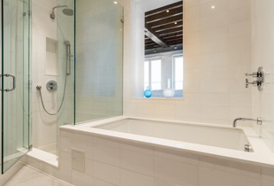 This rental offers a side-by-side standing shower and soaking tub