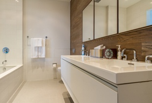 Instead of a wood vanity, the Dixon Projects team chose a wood feature wall for the master bath