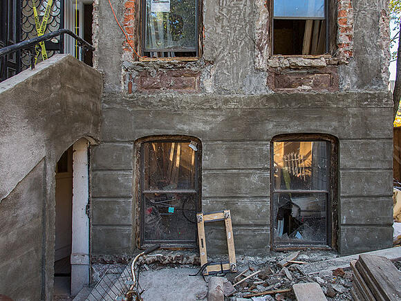 rundown brownstone facade