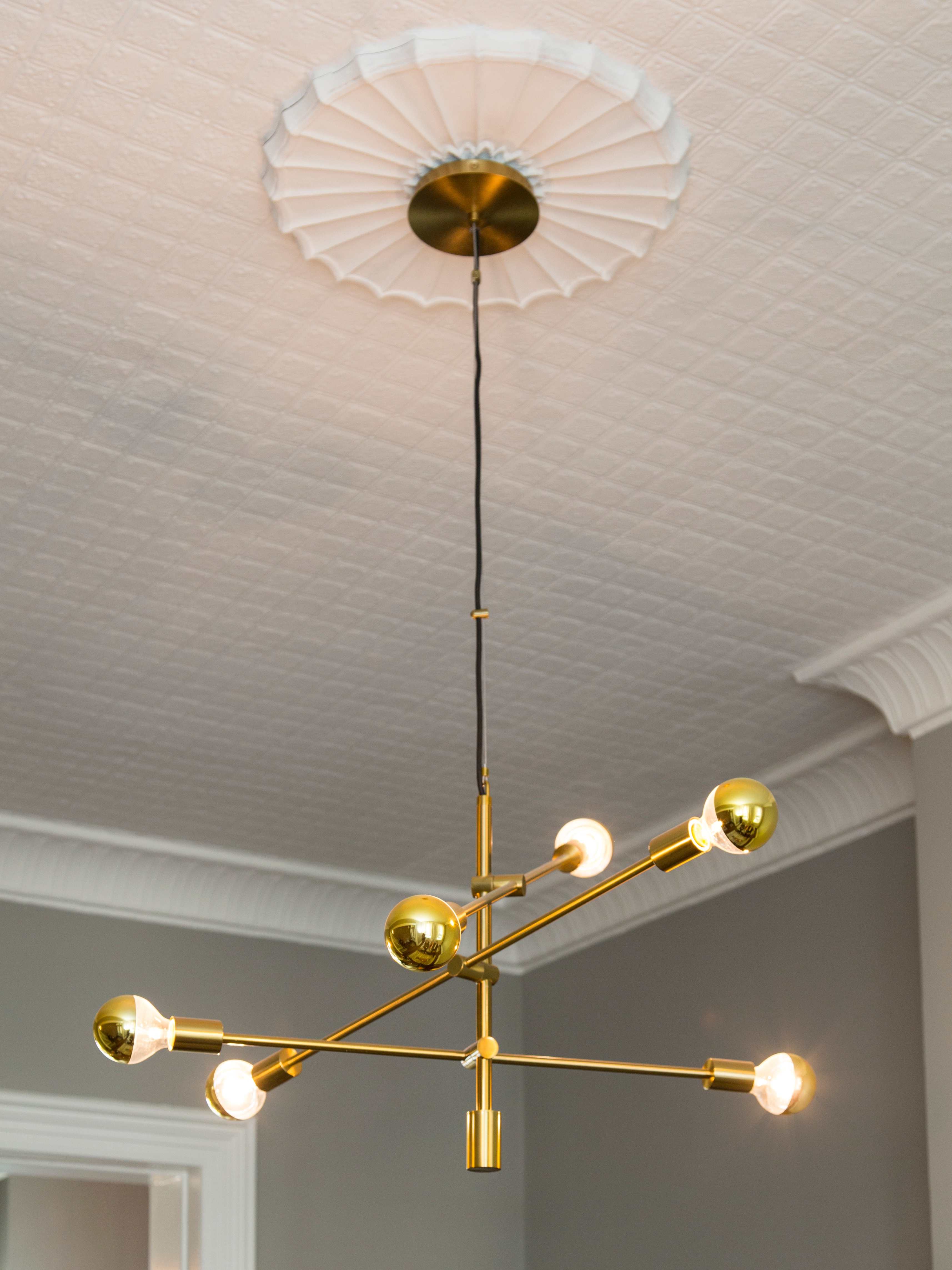 three-armed gold fixture